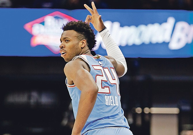 Sacramento Kings guard Buddy Hield flashes three fingers after scoring a three-point basket during the second half against the Miami Heat. Last night against the Detroit Pistons, he scored 20 points, including three three pointers, grabbed six rebounds, dished out four assists and had two steals in 33 minutes on the floor. However, the Pistons won 106-90.