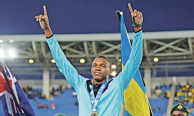 Joel Johnson on the podium with his 100m gold medal from the Carifta Games. Photo: Shawn Hanna/Tribune staff