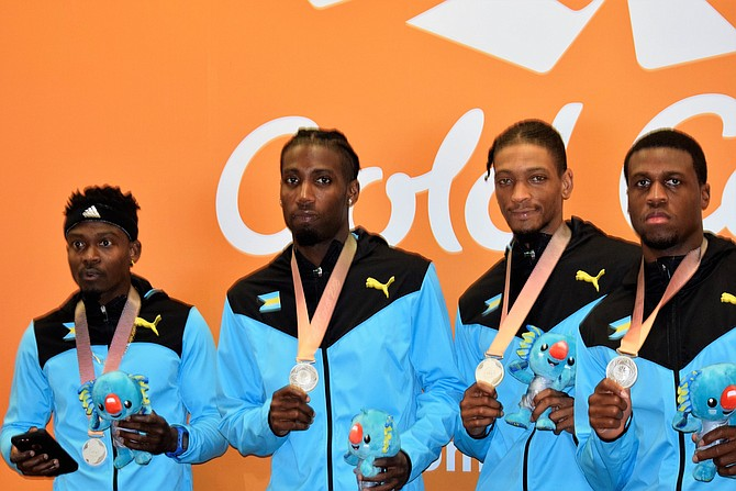 The men's 4x400 relay team with their silver medals.