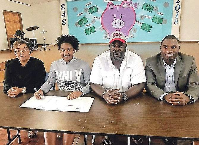 Acacia Ashwood is flanked by her mother, Shenika Ashwood, coach Corringron Maycock and BAAA's secretary general Drumeco Archer at her college signing.