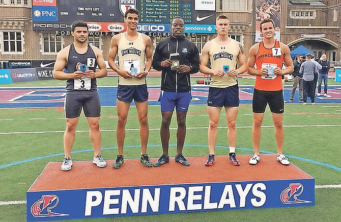 Ken Mullings on the medal podium yesterday after he took the gold in the college men's decathlon at the Penn Relays.
