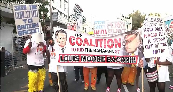 A protest held against Louis Bacon in Nassau.