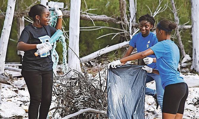 Youth volunteers help clean Barbary beach, in Freeport, Grand Bahama.