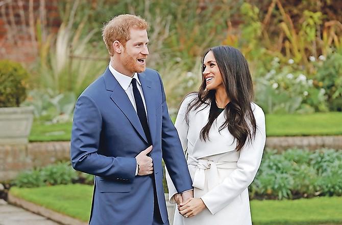Britain's Prince Harry and his fiancée, Meghan Markle. (AP Photo/Matt Dunham)