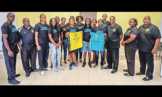 Bahamas women's national team members, inclusive of coaches and players, are pose above. Photo - John Nutt. 10th Year Seniors.