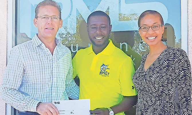 Brian Moodie, president RMS Insurance Co., presents Riccardo Davis, BPGT Founder and Director, with a cheque. At right is Rashanna Thompson of RMS.