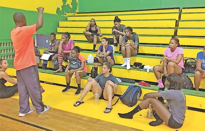 Head coach Covance Mortimer gives some instructions to members of the women's national volleyball team.