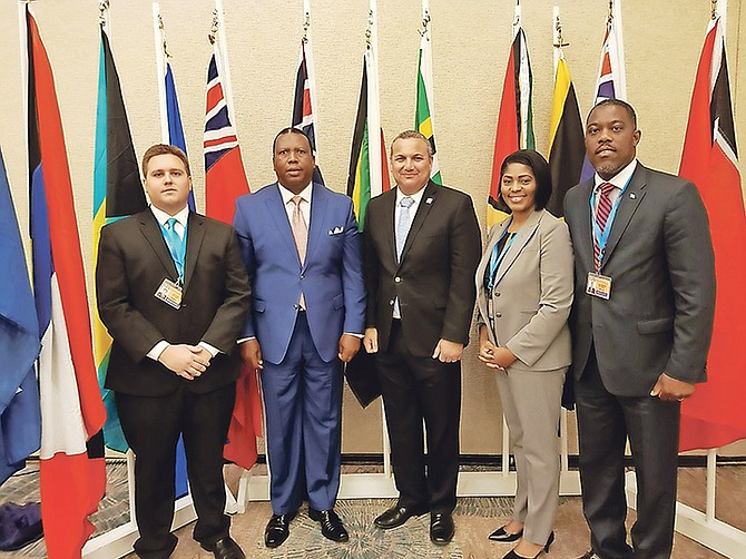 From left, Central and South Abaco MP James Albury, South Andros MP Picewell Forbes, pictured with an official, West Grand Bahama and Bimini MP Pakesia Parker-Edgecombe and Tall Pines MP Don Saunders were absent for the VAT vote on Monday due to the obligations in the Cayman Islands for a Commonwealth Parliamentary Association forum.