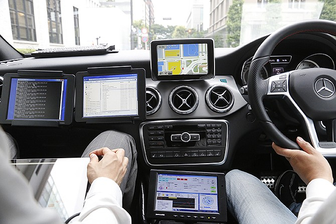 A car monitor shows a 3D digital map as it's driven through Tokyo streets. Technology companies are racing to develop ultra-precise three-dimensional digital maps that can guide self-driving cars to within inches of where they are supposed to be - a hurdle the industry needs to clear if it hopes to deliver on its promise of widespread use of driverless vehicles. Photo: Yuri Kageyama/AP