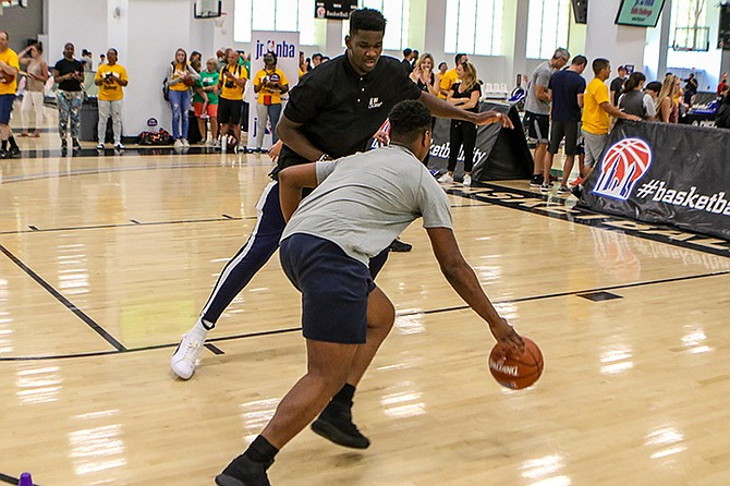 DEANDRE Ayton takes part in a Jr. NBA youth basketball clinic.