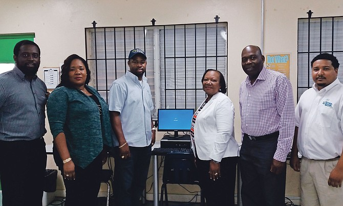 Bahamas Striping donated five new HP desktop computers to Programme SURE on Monday. From left, computer teacher Dion Johnson; Fredericka Sturrup, senior vice president of HR and training; BSGC's president Atario Mitchell; Principal Angela Hunt; Dr Allen Albury, BSGC's managing director and United Data Technologies Ltd president Quincy Rolle. Photo: Precision Media