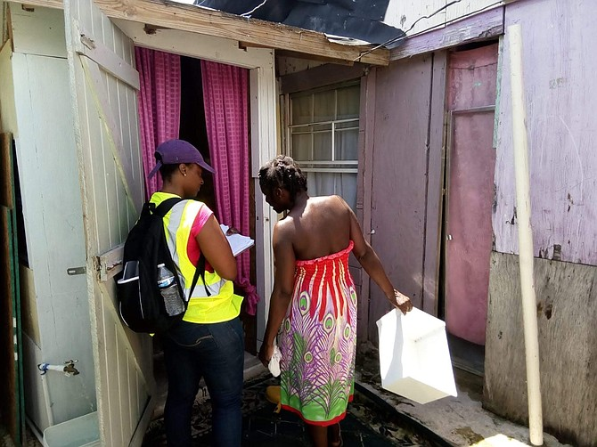 Government representatives canvass shanty town residents in Abaco