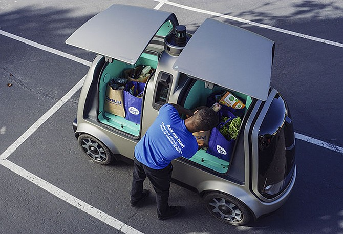 A driverless car that The Kroger Co will test. The Cincinnati-based company wants to see whether it can steer supermarket customers away from crowded grocery aisles with a fleet of diminutive driverless cars designed to lower delivery costs. The test programme announced last week could make Kroger the first US grocer to make deliveries with robotic cars that won't have a human riding along to take control in case something goes wrong. Photo: Andrew Brown/The Kroger Co/AP