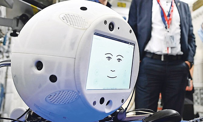 """Cimon"" (Crew Interactive MObile companioN), pictured during a communications test at the ESA European Astronaut Center in Cologne-Porz, Germany. The round, artificial intelligence robot is part of SpaceX's latest delivery to the International Space Station. Photo: AP"