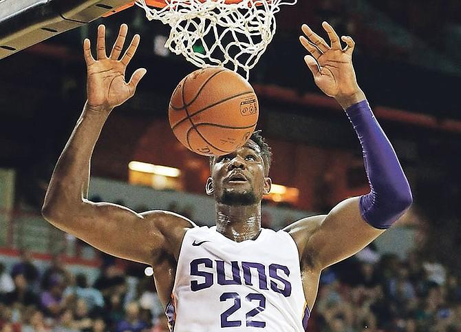 Phoenix Suns' Deandre Ayton dunks against the Dallas Mavericks during the second half of an NBA summer league game in Las Vegas.  (AP Photo/John Locher)