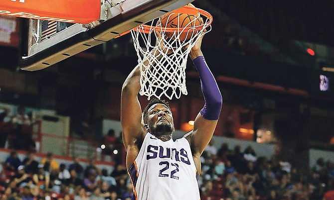 Phoenix Suns' Deandre Ayton dunks against the Dallas Mavericks during the second half of an NBA summer league basketball game on Friday in Las Vegas.