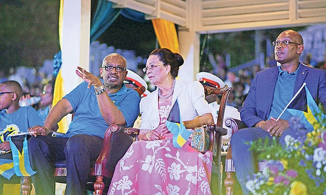 Prime Minister Dr Hubert Minnis, alongside Governor General Dame Marguerite Pindling and Mark Humes, Fort Charlotte MP, during The Bahamas' 45th Grand Independence Celebrations at Clifford Park. Photo: Shawn Hanna/Tribune Staff