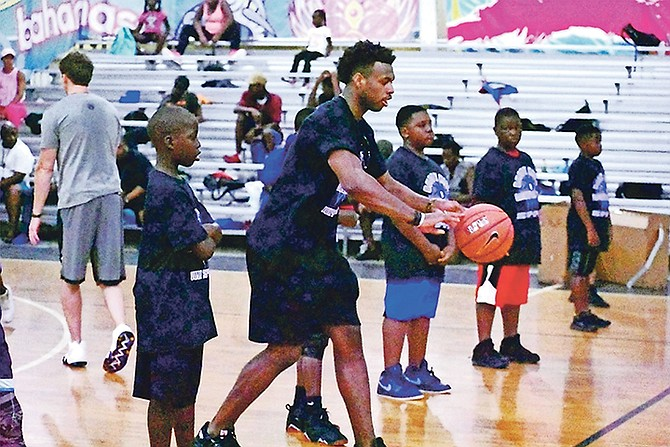 KINGS guard Buddy Hield runs through some drills with the young campers during his fourth Summer Basketball Camp, which is being held in Freeport and Eight Mile Rock, Grand Bahama.