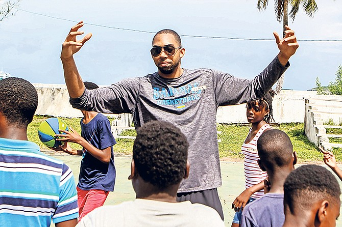 """PROFESSIONAL basketball player and national team standout Jaraun """"Kino"""" Burrows talks to young, aspiring players in Eleuthera about the game of basketball."""