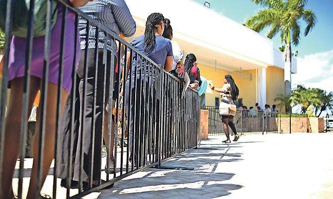 JOBSEEKERS pictured last year at an Island Luck job fair. Photo: Terrel W Carey/Tribune Staff