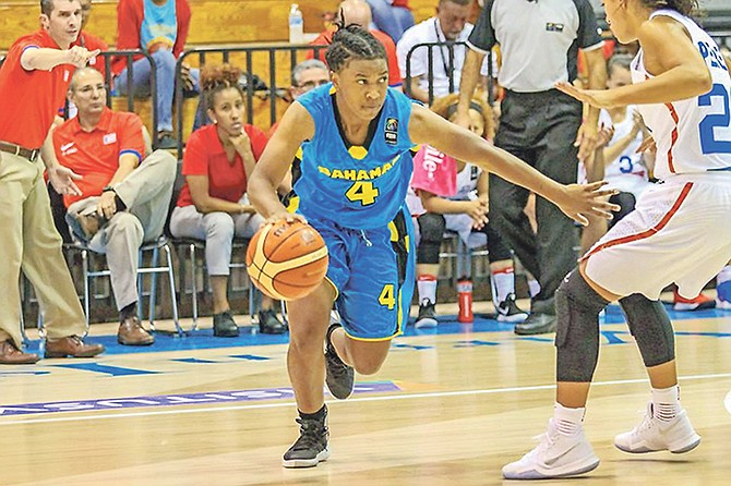BAHAMIAN national team standout Valerie Nesbitt (in action above) will become the first local player signed by Yolett McPhee-McCuin in her tenure as the head coach of the Ole Miss Rebels women's basketball programme.