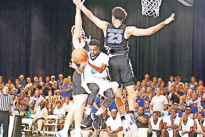 Michael Bain (centre) in action during the Big Blue Bahamas Tour against the Kentucky Wildcats, who won 85-61 in front of a crowd of 1,290 fans in the Imperial Arena at the Atlantis resort. Photo: 10thYearSeniors
