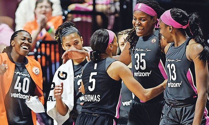 Connecticut Sun guard Jasmine Thomas (5) is greeted by teammates, from left to right, Shekinna Stricklen, Alyssa Thomas, Jonquel Jones and Chiney Ogwumike as she comes out of a WNBA basketball game against the Las Vegas Aces on Sunday. (AP)