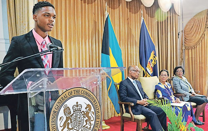 All-Bahamas Merit Scholar 2018 Aaron Edgecombe addresses the All-Bahamas Merit and National Merit Scholars Award Ceremony at Government House on August 9. Pictured at right: Minister of Education Jeffrey Lloyd, Governor General Dame Marguerite Pindling, and Ministry of Education Permanent Secretary Lorraine Armbrister. Photo: Derek Smith/BIS