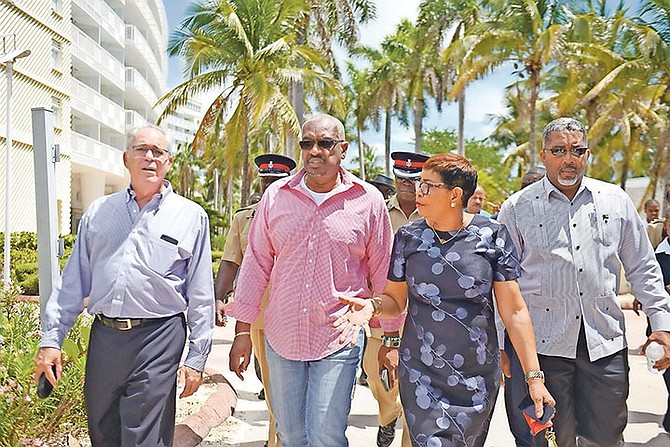 A government delegation headed by Prime Minister Dr Hubert Minnis tours the Grand Lucayan Resort led by hotel manager Veronica Clarke, right. 