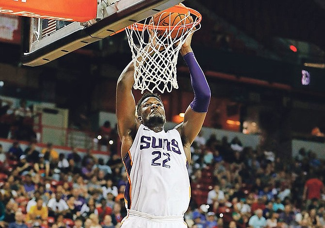 Phoenix Suns' Deandre Ayton dunks against the Dallas Mavericks during the second half of an NBA summer league basketball game on July 6 in Las Vegas.