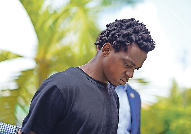 William Etienne, 26, outside Magistrate's Court in connection with the recent murder of Alvin Strachan. Photo: Shawn Hanna/Tribune Staff