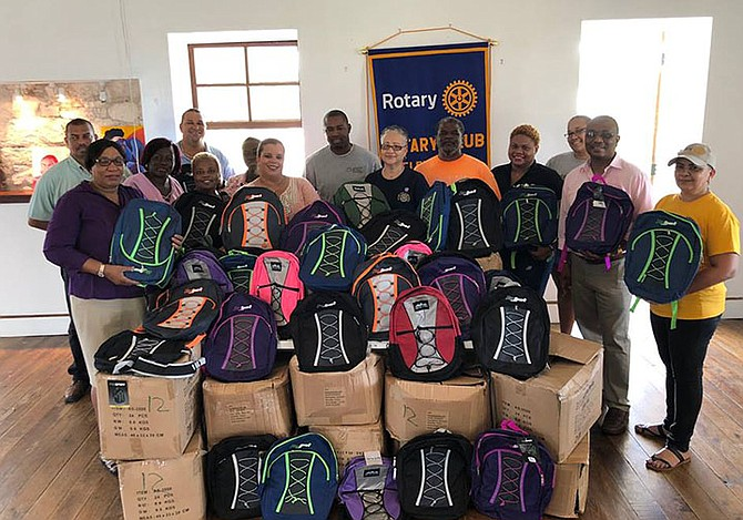 Bahamas Striping Group of Companies led by president Atario Mitchell presented president of the Rotary Club of Eleuthera, Sandra Ingraham and her team with 620 school bags for distribution at four of the island's primary school and one high school.