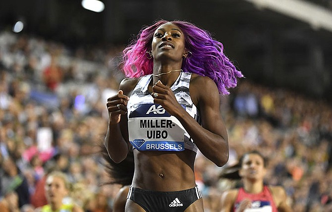 Shaunae Miller-Uibo crosses the finish line to win the women's 200 metres during the Diamond League Memorial Van Damme athletics event at the King Baudouin stadium in Brussels on Friday. (AP Photo/Geert Vanden Wijngaert)