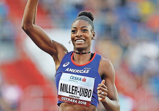Shaunae Miller-Uibo celebrates as she crosses the finish line to win the mixed 4x400 metres relay for the Americas at the IAAF track and field Continental Cup in Ostrava, Czech Republic. (AP)