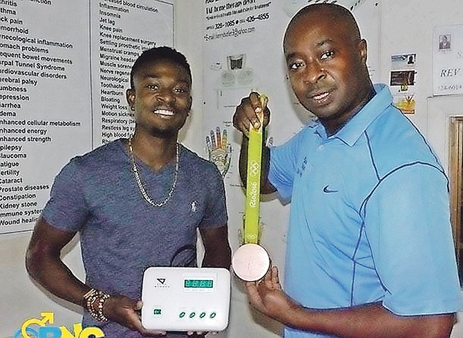 Alonzo Russell, silver medallist in the 4x400m in 2016 World Indoors and bronze medallist in the Rio de Janeiro Olympics, with Henry A Butler and his TAB device.