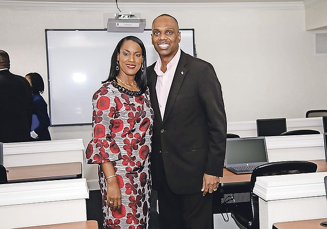 THE Rev Frederick McAlpine, MP for Pineridge, and his wife Tracey in one of the classrooms at his recently opened Pineridge Education Centre.
