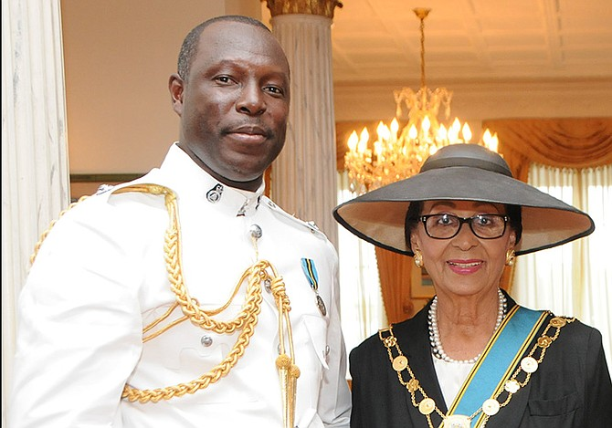 Inspector Carlis Blatch pictured with Governor General Dame Marguerite Pindling. Photo: Franklyn G Ferguson