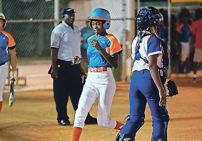 PLAY ACTION: The youthful Platinum Lady Sharks last night steamrolled past the Johnson's Lady Truckers 11-4 in six innings to force a fifth and deciding game in their New Providence Softball Association semi-final series. 