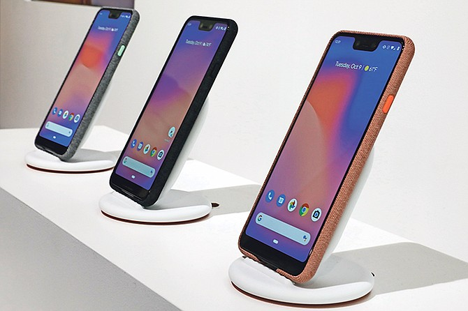 New Google Pixel 3 smartphones are displayed in New York. Google introduced two new smartphones in its relentless push to increase the usage of its digital services and promote its Android software that already powers most of the mobile devices in the world. Photo: Richard Drew/AP