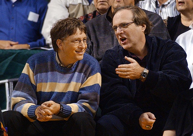 Microsoft Chairman Bill Gates, left, chats with Portland Trail Blazers owner and former business partner Paul Allen during a game between the Trail Blazers and Seattle SuperSonics in Seattle in 2003. (AP)
