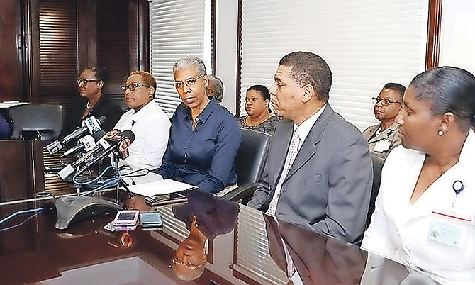 Catherine Weech, managing director, Public Hospitals Authority, (third from left) announces a new shift system for nurses yesterday. Seated from left, nursing services advisor Lillian Black-Charlton; Valerie Miller, principal nursing officer, Princess Margaret Hospital; Mrs Weech; deputy managing director, PHA, Lyrone Burrows and Thelma McKenzie. principal nursing officer, Sandilands Rehabilitation Centre.   Photo: Raymond A Bethel Sr/BIS