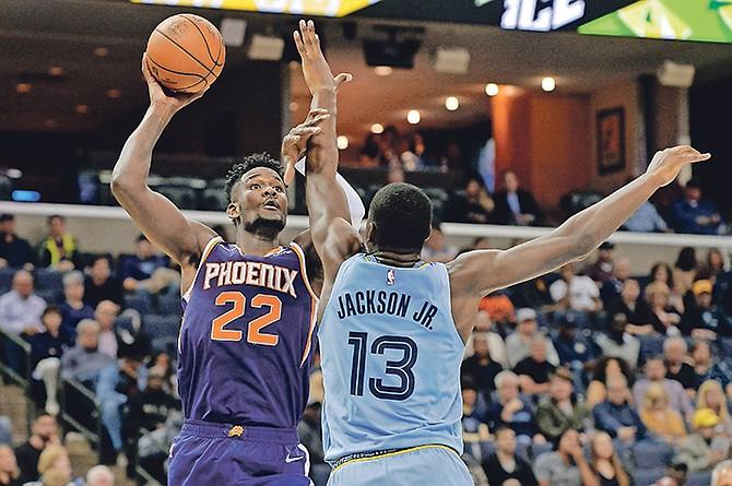 Phoenix Suns centre Deandre Ayton (22) shoots against Memphis Grizzlies forward Jaren Jackson Jr. (13) on Saturday.  (AP Photo/Brandon Dill)