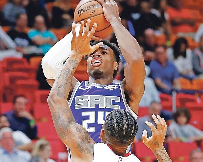 Sacramento Kings guard Buddy Hield takes a shot against Miami Heat forward Rodney McGruder (17) in the first half in Miami.  (AP Photo/Wilfredo Lee)