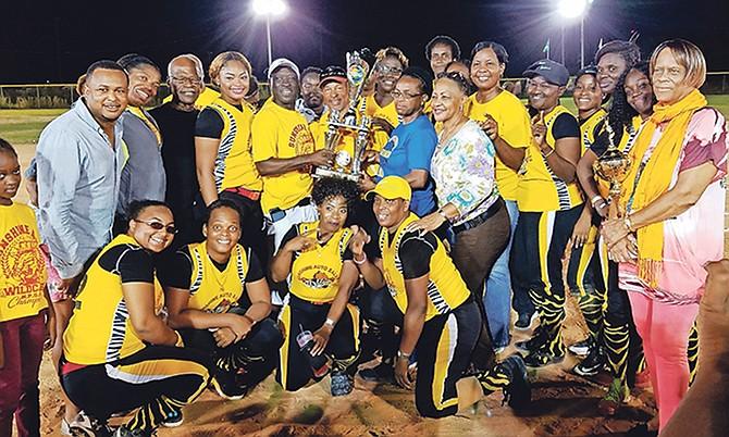 The Sunshine Auto Wildcats celebrate winning their title.
