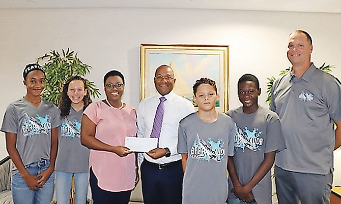 SHOWN (from left to right) are Devin Cuffy-Bethel, Grace Farrington, Philice Albury, president of the Barracuda Swim Club, Andre White, assistant vice president of investments at Family Guardian, Reis Knowles, Hodari Prince and Jeff Slater, head coach, Barracuda Swim Club.
