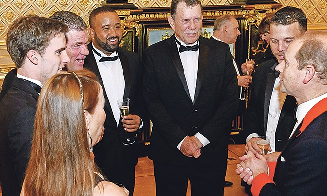 SHOWN (from left to right) are Silvina Andrews, Spencer Andrews, Phil Andrews, Andrew Bell, Patrick Knowles, Ryan Knowles and Prince Andrew Earl of Wessex.