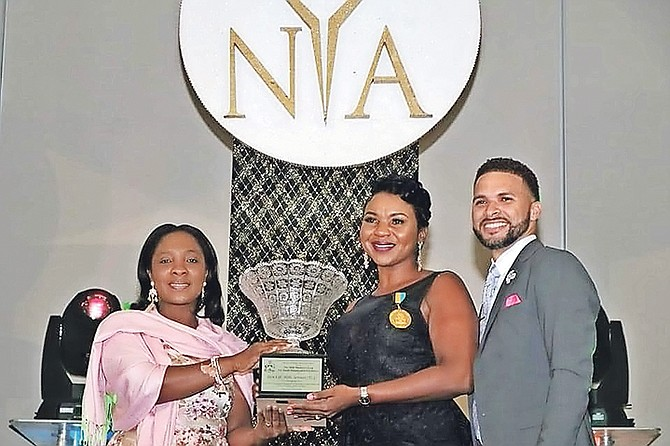 Felicia Campbell receives the Minister's Cup for Youth Excellence for her Teen Life Skills Services to help young parents.