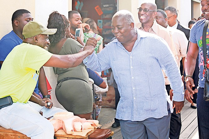 PLP leader Phillip 'Brave' Davis touring the downtown Straw Market with other members of the PLP. Photo: Donavan McIntosh