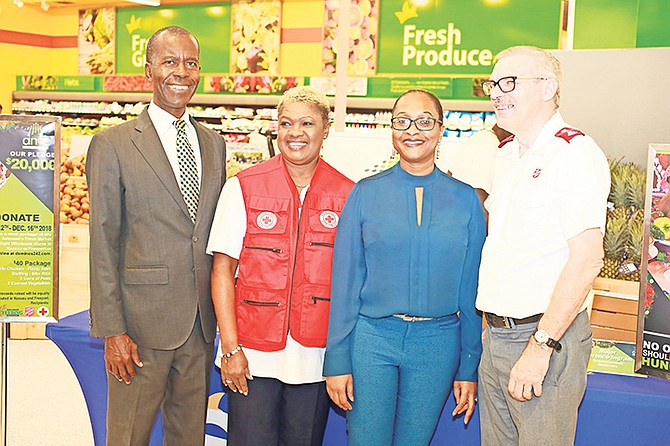 At the AML Foods press conference at Solomons Fresh Market East are, from left, Philip Smith (executive director of Bahamas Feeding Network) Janice Bain-Mackey (HR & logistics manager of The Bahamas Red Cross), Renea Bastian (VP marketing & communications of AML Foods Ltd), and Major Clarence Ingram (divisional commander of the Salvation Army).