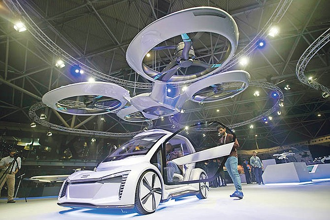 PopUp Next, a prototype designed by Audi, Airbus and Italdesign is displayed at the Amsterdam Drone Week in Amsterdam, Netherlands, yesterday. The two-seater vehicle combines combines ground transportation with vertical take-off and landing capabilities. Photo: Peter Dejong/AP
